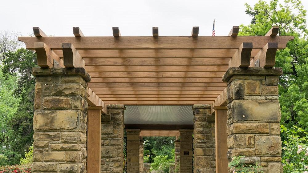 an arbor pergola patio cover is