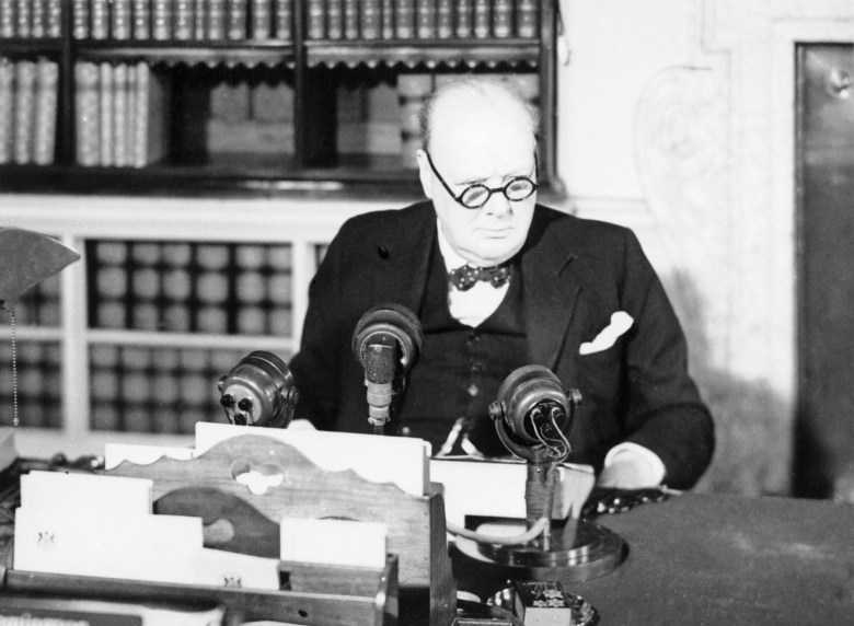 Winston_Churchill_at_a_BBC_microphone_about_to_broadcast_to_the_nation_on_the_afternoon_of_VE_Day,_8_May_1945._H41843