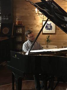 Thomas Hammerton playing a grand piano