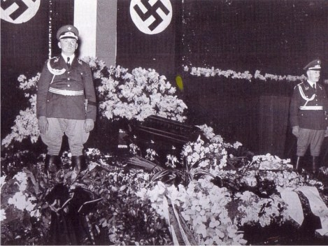 FEBRUARY 1939: The coffin of Sir Henri Deterding flanked by Nazi-soldiers and the swastika flag.