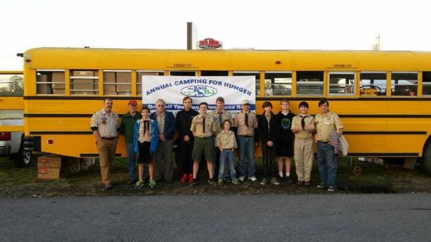 COURTESY PHOTOS/THE RIVER 95.3 For one week each year, The River 95-3 'Camping for Hunger' bus is ground zero for the holiday spirit of giving in this community. Scout Troop 52's Venture Club was among the visitors helping stock the bus.