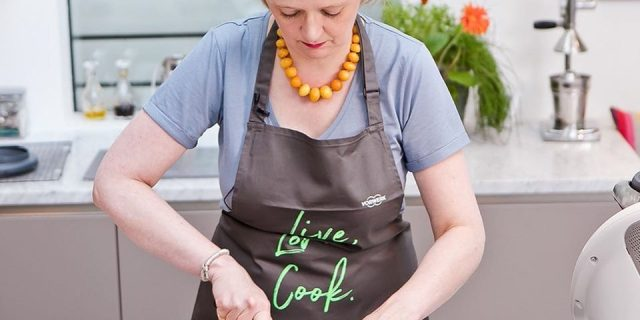 Helen Best Shaw cooking in a kitchen