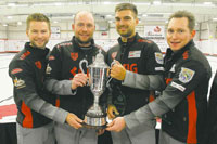 Mike McEwen (left) and his team of B.J. Neufeld, Matt Wozniak and Denni Neufeld hold the Dave Elias Memorial Trophy after winning the 2013 Canad Inns Prairie Classic. McEwen is a former agent at Royal LePage Prime Real Estate and Denni Neufeld remains as one of the firm's top agent.