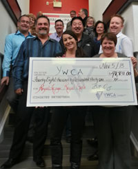 Presenting the proceeds from their Annual Royal Gala and Auction to YWCA Haven House Board President Monica Cove (front right) are Royal LePage South Country Broker/Owner Brent Oleksy and Committee Chair Teresa Lawrence.