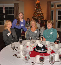 Royal LePage Grand Valley agents Jessica March (standing) and Lisa Hube (seated to her left) pictured with their guests.