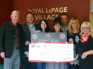 Royal LePage Village VIP Casino Royal Committee members present funds raised to representatives from local women's shelter.  From L-R: Grant Staley, Stephane Cassan, Veronique Girard (La Passerelle), Madeleine Chenier (La Passerelle), David Pidgeon, Marie-Eve Dandurand and Brigitte Beaudry.