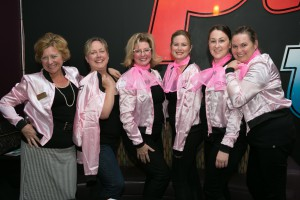 A team of Pink Ladies from Royal LePage Meadowtowne Realty, from L to R: Susan Lougheed (broker), Carrie Dodds (sales representative), Jacquie Sullivan (sales representative), Tracy Weatherall (agent services administrator), Ashley Dwyer (agent services administrator), and Tammy Scott (sales representative)