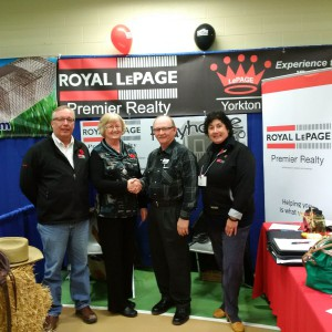 Pictured with playhouse winner Janice Pilipow (centre) are Royal LePage Premier Realty REALTORs® (L-R): Murray Arnold, Larry Hanowski and Gaylene Skinner
