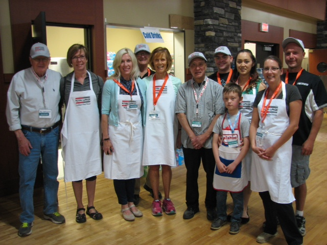 Volunteers from Royal LePage Lakeland Real Estate stand outside the kitchen at the Bold Centre in Lac la Biche as they prepare a dinner on Friday, May 6 for evacuees. L-R: Roy Worthington, Carrie Dechaine, Tracey Thompson, Ron Moore, Jane Moore, Patrick Cheung, Tyler MacDonald, Taisya Reutov, Alexander Reutov, Tanya Duchnych and Cory Sturek.