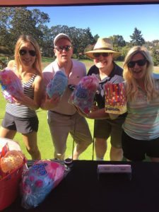 Golfers enjoy a candy break at the Royal LePage Coast Capital Realty Golf Party. From L to R: Mikaila Rhodes, Andrew Swan, Luke Beckner and Tasha Medve.