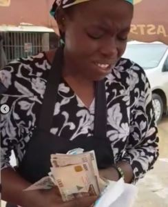 Pastor Adeboye's son, Leke gifts corn seller money after spotting her praying over her charcoal pot (video)