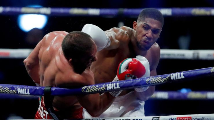 Joshua knocks out Pulev to retain heavyweight titles