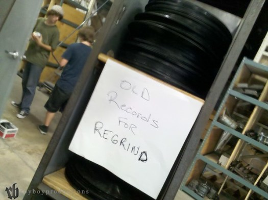 a stack of old records that are unplayable, about to be made into new records after grinding & melting down.