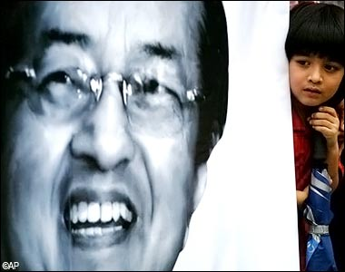 The image of Dr Mahathir will remain iconic to Malaysians. In this file photo, a young supporter is seen standing beside the portrait of Mahathir Mohamad outside an airport in Subang, Malaysia, May 27, 2008