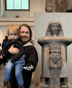 Roy Orbison Jr and Roy Orbison III with a 3,200 year old statue of Roy (an Egyptian high priest from the time of Ramses II )
