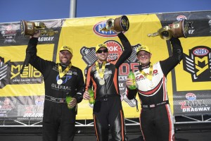 Funny Car pilot Shawn Langdon, Top Fuel pilot Steve Torrence, and Pro Stock Motorcycle rider Andrew Hines in the Charlotte I winners circle