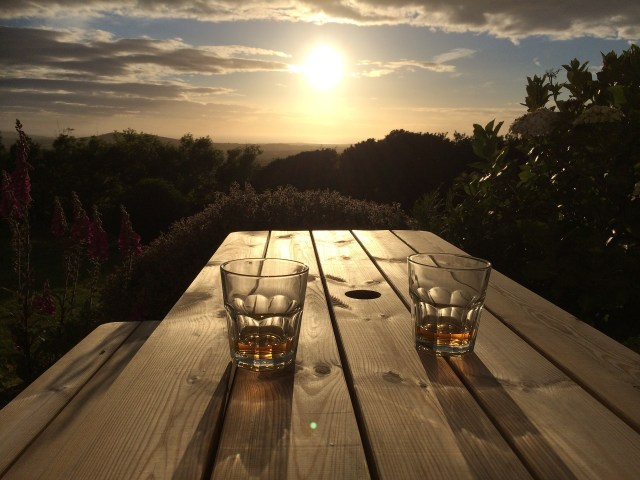 2 glasses with scotch whiskey and a sunset.