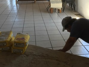 Francisco Villa sets tiles on main floor before moving on to the alter