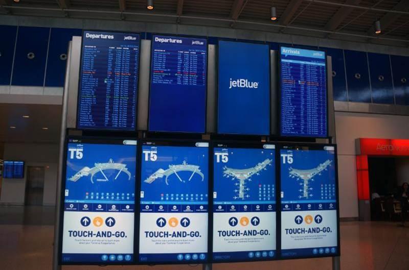 Multi screen display JFK Airport
