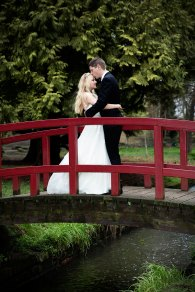 Bournemouth wedding photographer photo of the bride and groom at Coy Pond in Bournemouth, Dorset