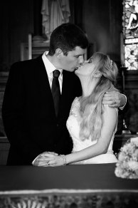 Bride and groom kiss in the church
