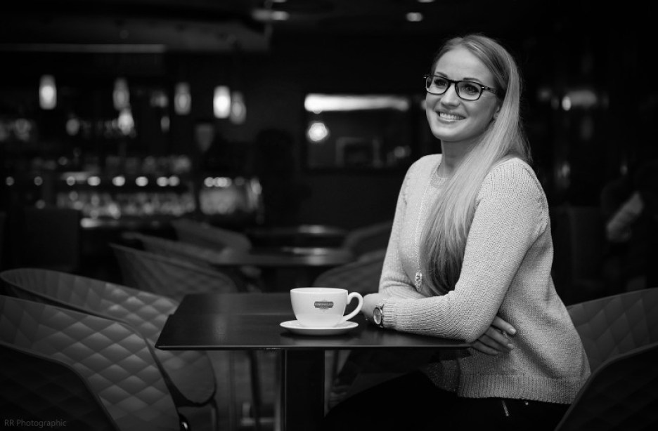 Black and white photo of blonde Ruta sat at table