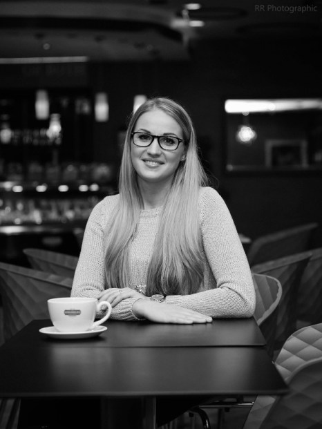 Black and white photograph of blonde Ruta at Sprinkles cafe in Bournemouth