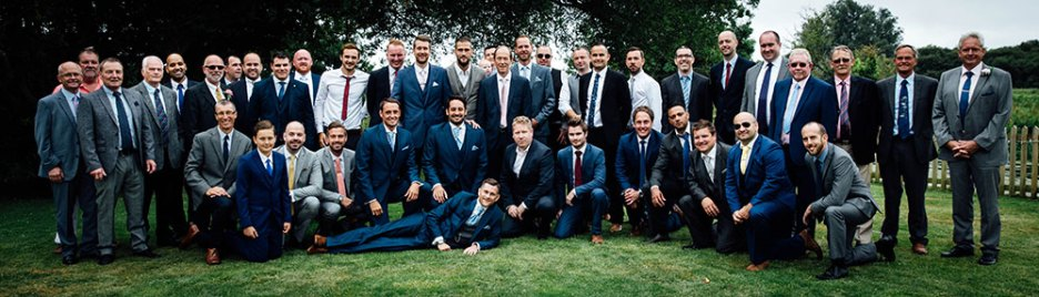 Group photo of all the male wedding guests