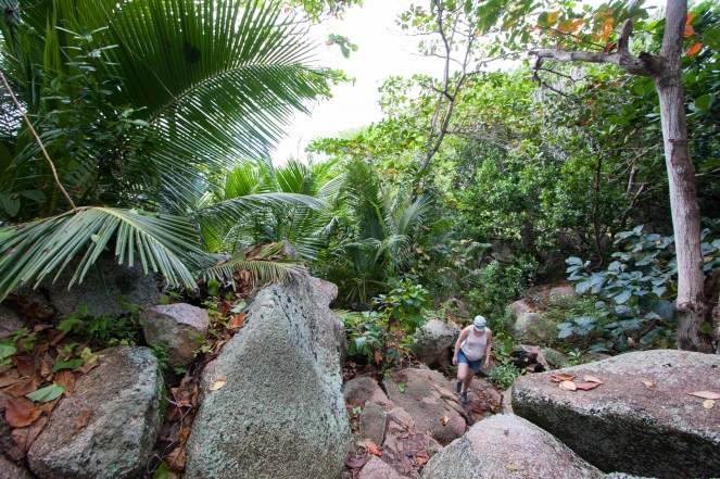 walking the connecting path between beaches on La Digue