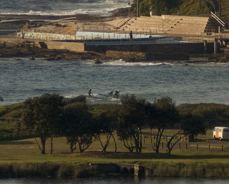 0700: multiperson wave trickles in to Dee Why beach.