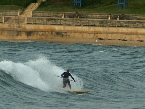 Not the meatiest wave ever, but he is up and riding at DY beach.