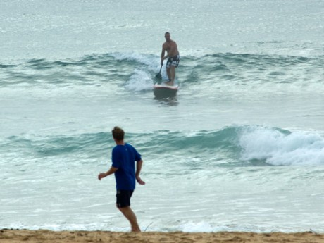 SUP rider sets up a short glide to the sand at Longy.