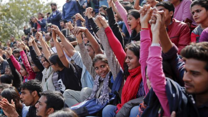Indian students shout slogans during a protest at the Jawaharlal Nehru University against the arrest of a student union leader in New Delhi, India, Tuesday, Feb. 16, 2016. Students, journalists and teachers protested in the Indian capital Tuesday after a student union leader's arrest and subsequent violence by Hindu nationalists. The uproar has once again sparked allegations that Prime Minister Narendra Modi's government and his Hindu nationalist Bharatiya Janata Party are displaying intolerance and cracking down on political dissent in the name of patriotism. (AP Photo /Tsering Topgyal)