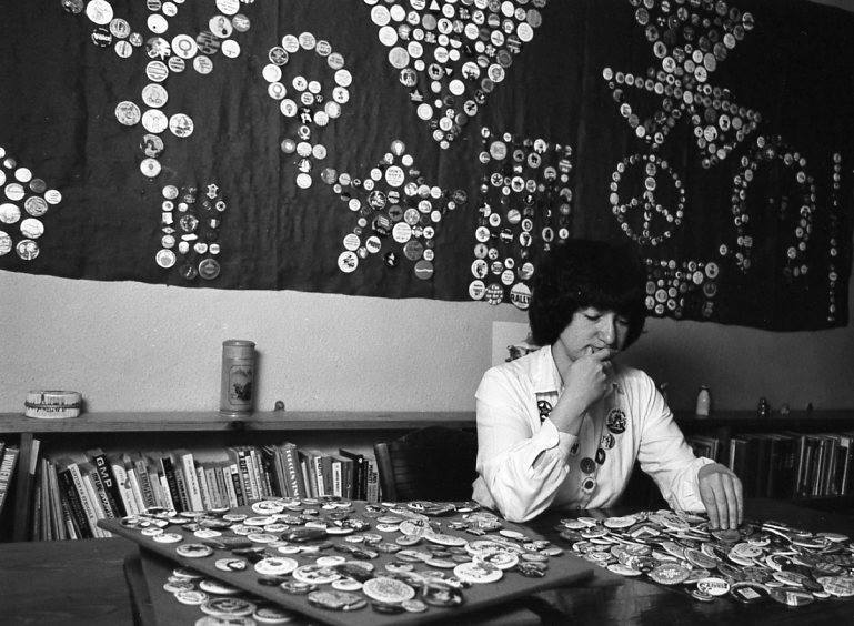 Sherrl with her extensive badge collection in 1980