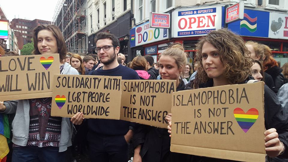 Protesters hold placards, some reading Islamophobia is not the answer