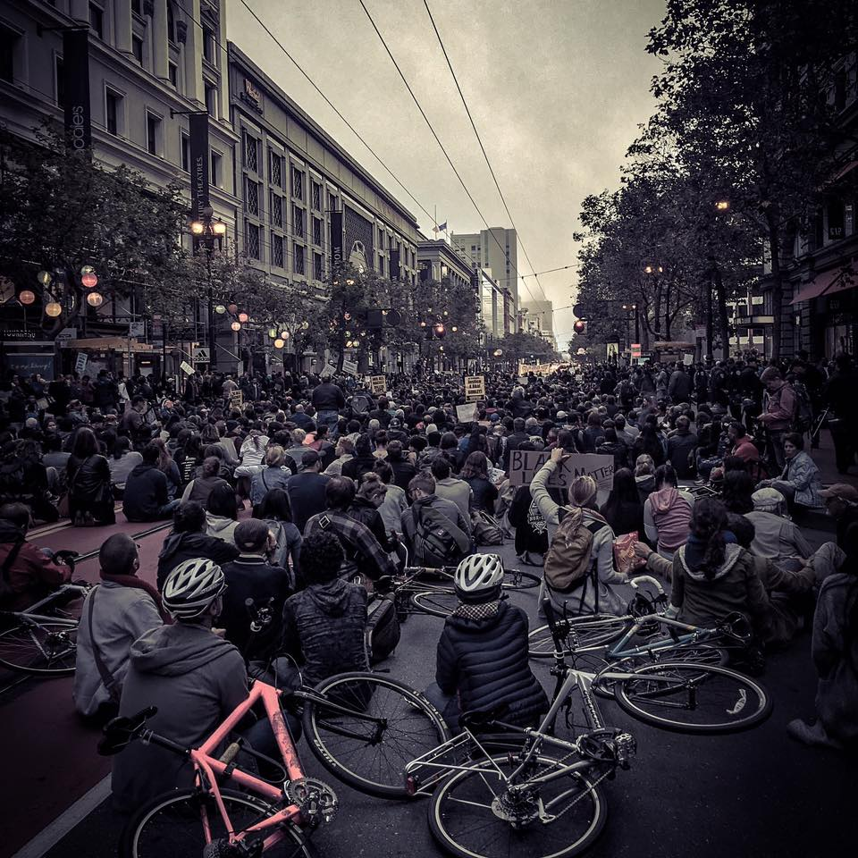 """Thousands sit-on on the streets of San Francisco for black lives."" Source"