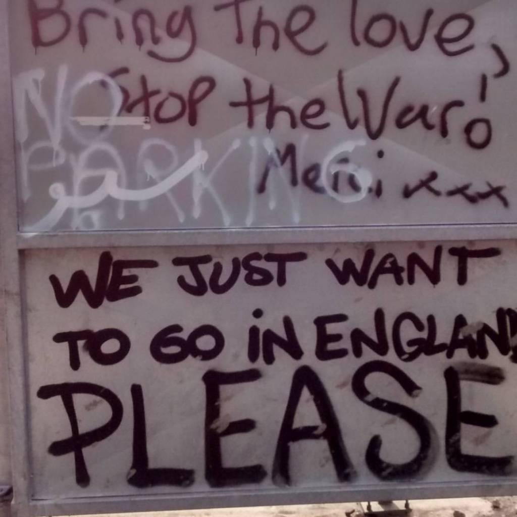 Sign at the edge of the Calais camp (Photo: Mitch Mitchell)