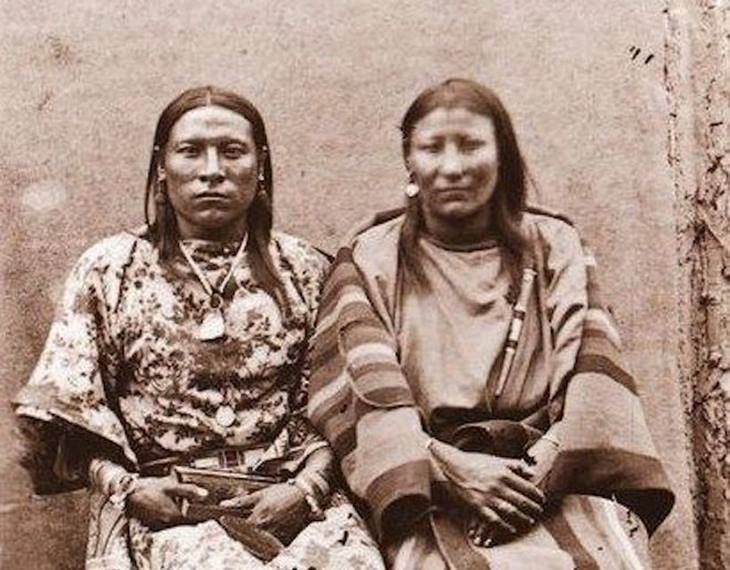 """Osh Tisch (left) of the Crow nation with their wife. The name means """"finds them and kills them"""""""