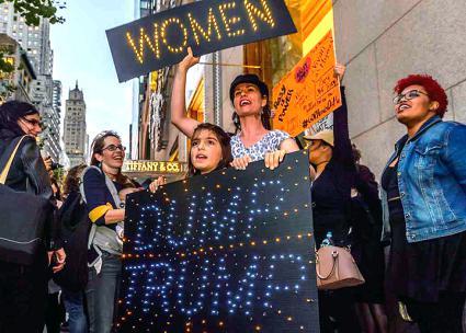 Women march in midtown Manhattan against Trump's sexism and bigotry