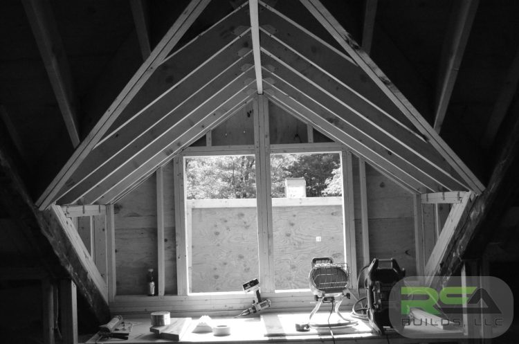 The framing for a shed dormer that was designed by us to open up an office space.