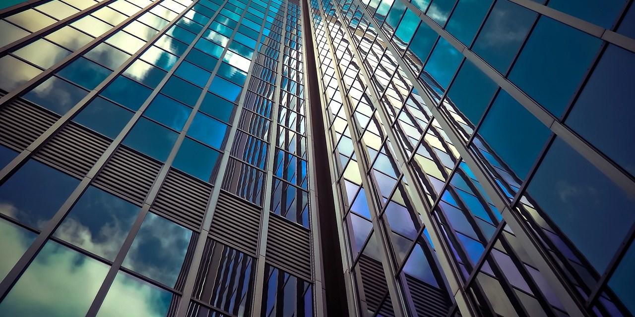 Skyscraper windows reflect the sky