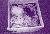 Inside the journey box. Showing the open gift box, the gift packaging straw, and the pieces included. More pieces can be added, or pieces changed as required. Photography by Rose-Sky Journey Pieces, copyright 2016.