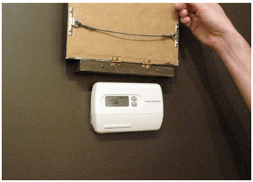 apartment therapy - thermostat uncovered