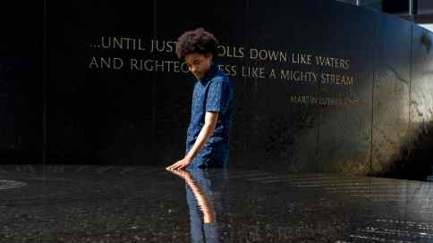 A visitor at the Civil Rights Memorial in Montgomery. (U.S. Civil Rights Trail)