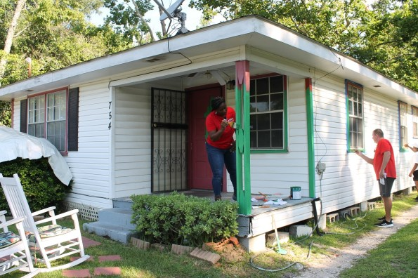 APSO volunteers paint and do other improvements to homes in Africatown. (contributed)