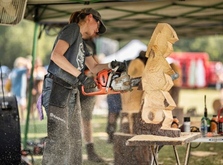 Heather Bailey of Calera is one of the five chainsaw carvers who will be creating one-of-a-kind pieces throughout the day. (Chris Jones)