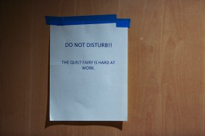 A mythical Quilt Fairy visits when the sewing room is closed, leaving quilt-related gifts at quilters' sewing machines. (Meg McKinney / Alabama NewsCenter)