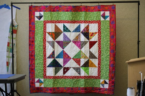 The retreat's theme, Building Better Quilts 2021, uses squares and triangles, basic shapes of quilt construction, in the Friendship quilt for the retreat. Quilters traded blocks with the same shapes to make a Friendship quilt with blocks from other quilters. This is Meg McKinney's Friendship quilt. (Meg McKinney / Alabama NewsCenter)