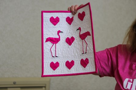 Small details for quilt making, such as flamingoes' feet and beaks, are made with paper piecing techniques, presented by Susan Hill Lee. (Meg McKinney / Alabama NewsCenter)