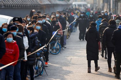 Beijing tests massive COVID as cases drop slightly in China